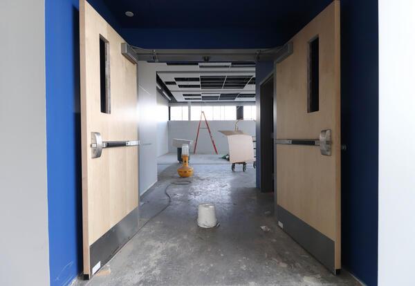 View of construction site through open double doors