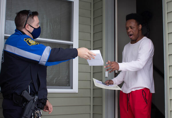 School resource officer Chris English surprises Albany High School senior Wazier Dozier when he presents him with a Samsung tablet through 'Do the Right Thing.'