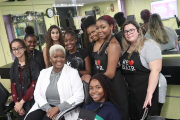Cosmetology teacher LaQuita Love with her students