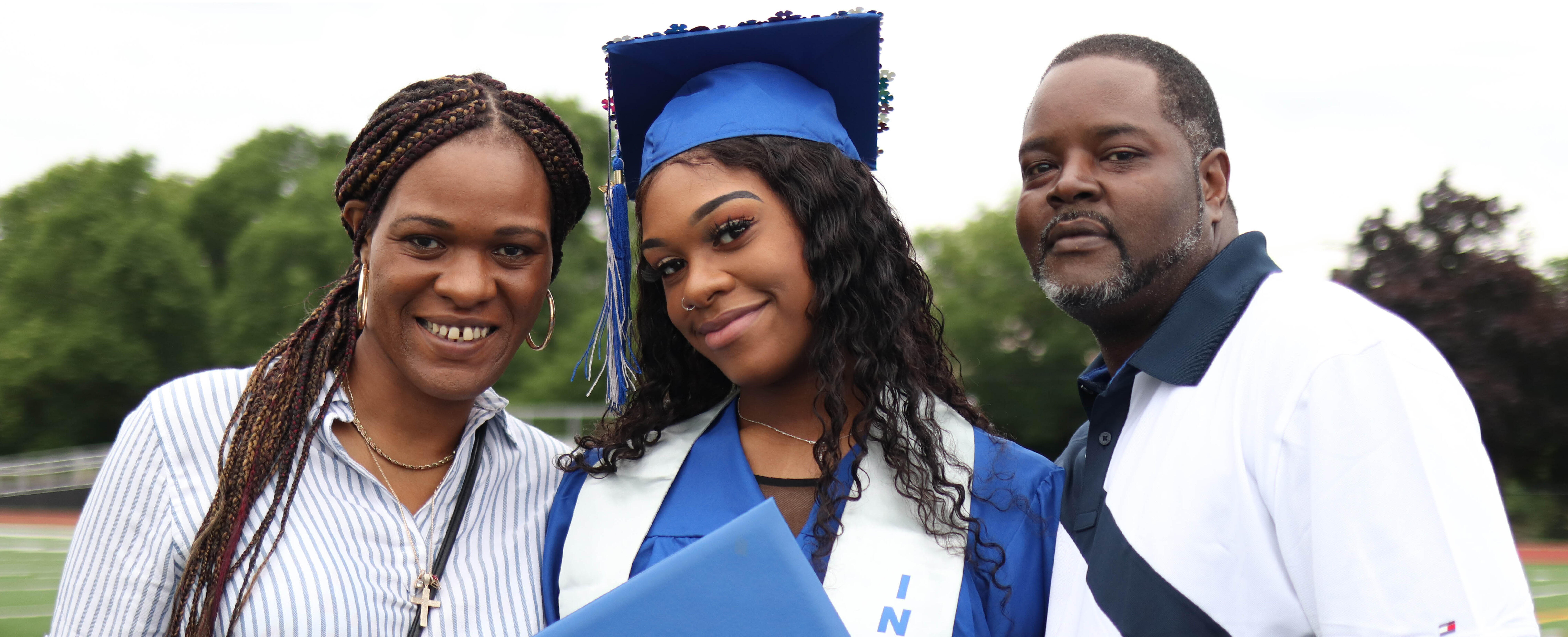 Albany High graduate posing for picture with family