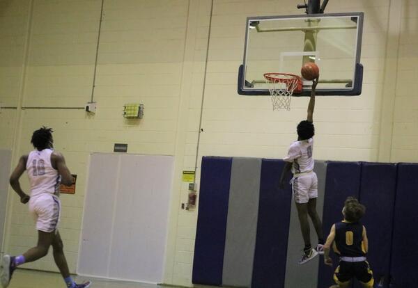Basketball player Isaiah Austin vs. Averill Park.