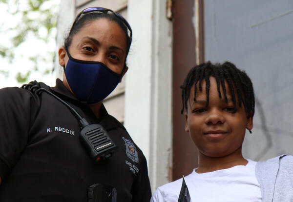 School resource officer stands with student
