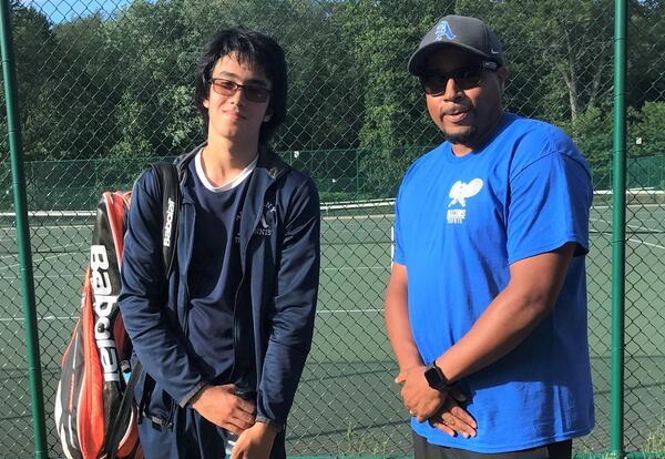 Masami Suriwasa poses with his coach.