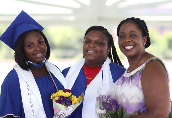 From left to right, graduating Albany High female, graduating Albany High male and Superintendent Kaweeeda G. Adams