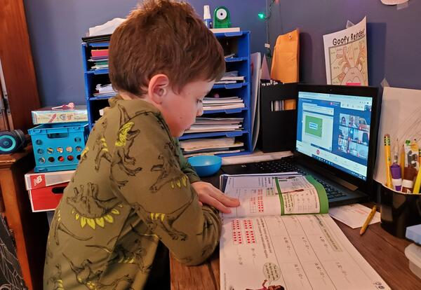 Elementary student engaged in virtual learning at home.