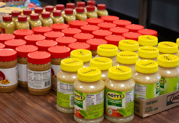 Jars of applesauce and peanut butter