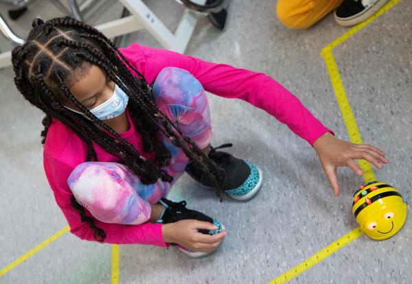 Girl operates robotic bee