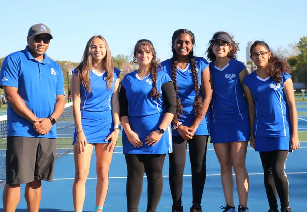 The graduating members of the girls' tennis team pose for a picture.