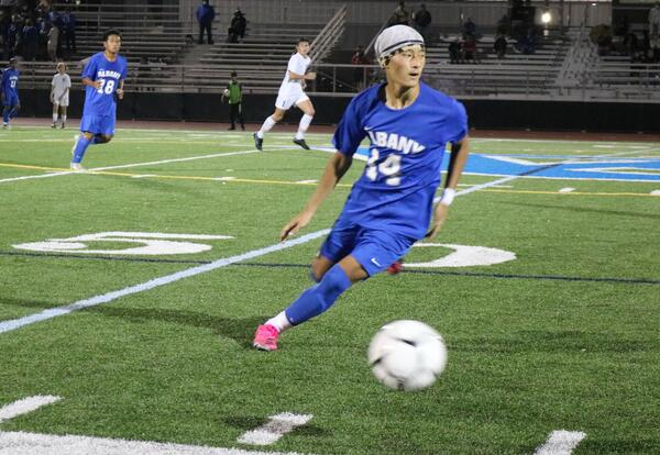 Albany High boys' soccer player in action