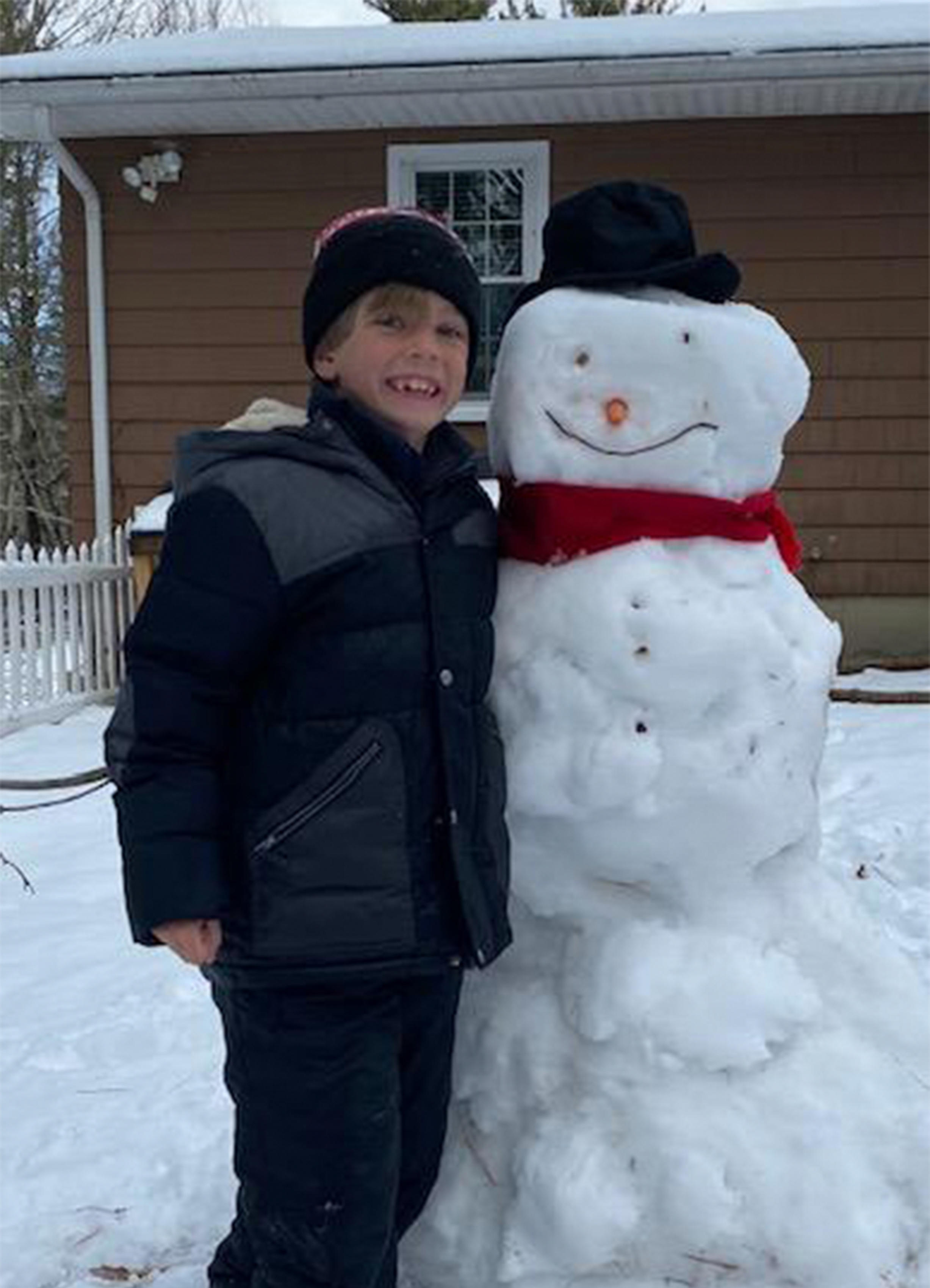 kid with snowman