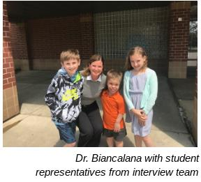 Dr. Biancalana with student representatives from interview team