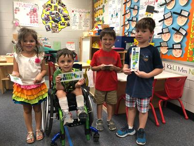 Pre-K Students with Library Bookmarkers