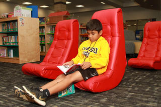 Student reads in Media Center