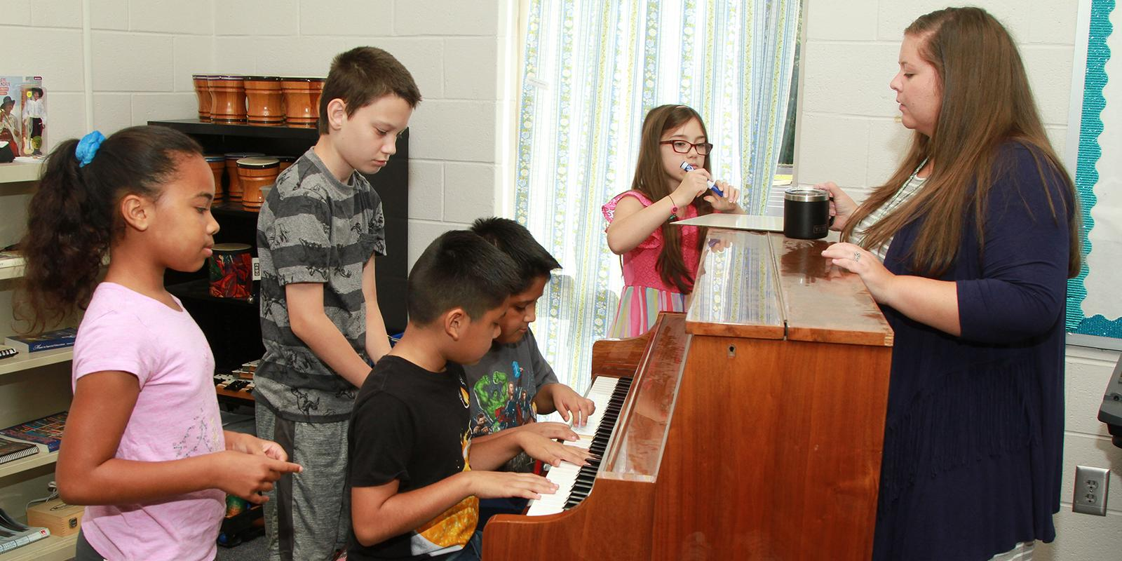 Students playing the piano