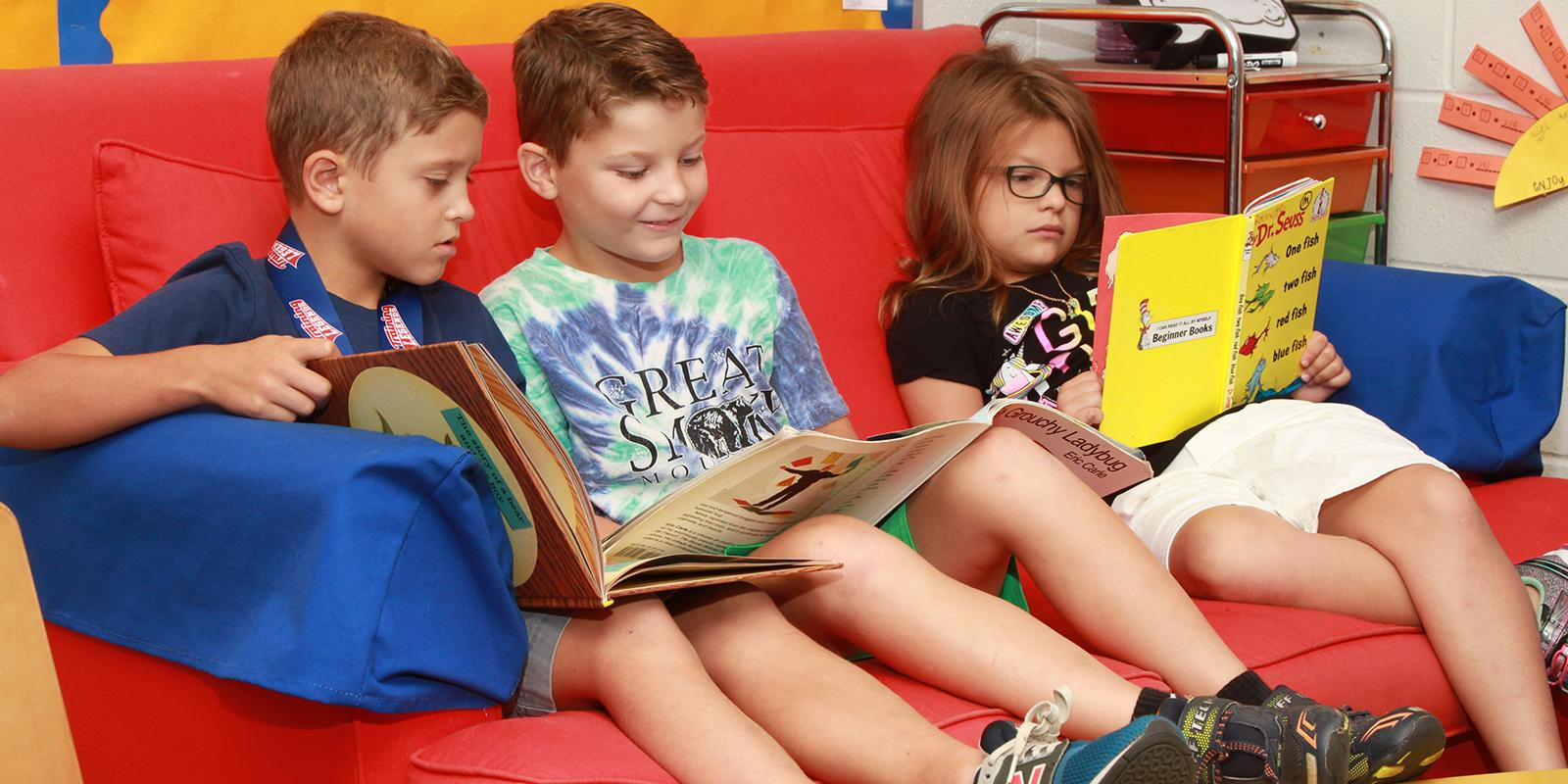 Three students read books