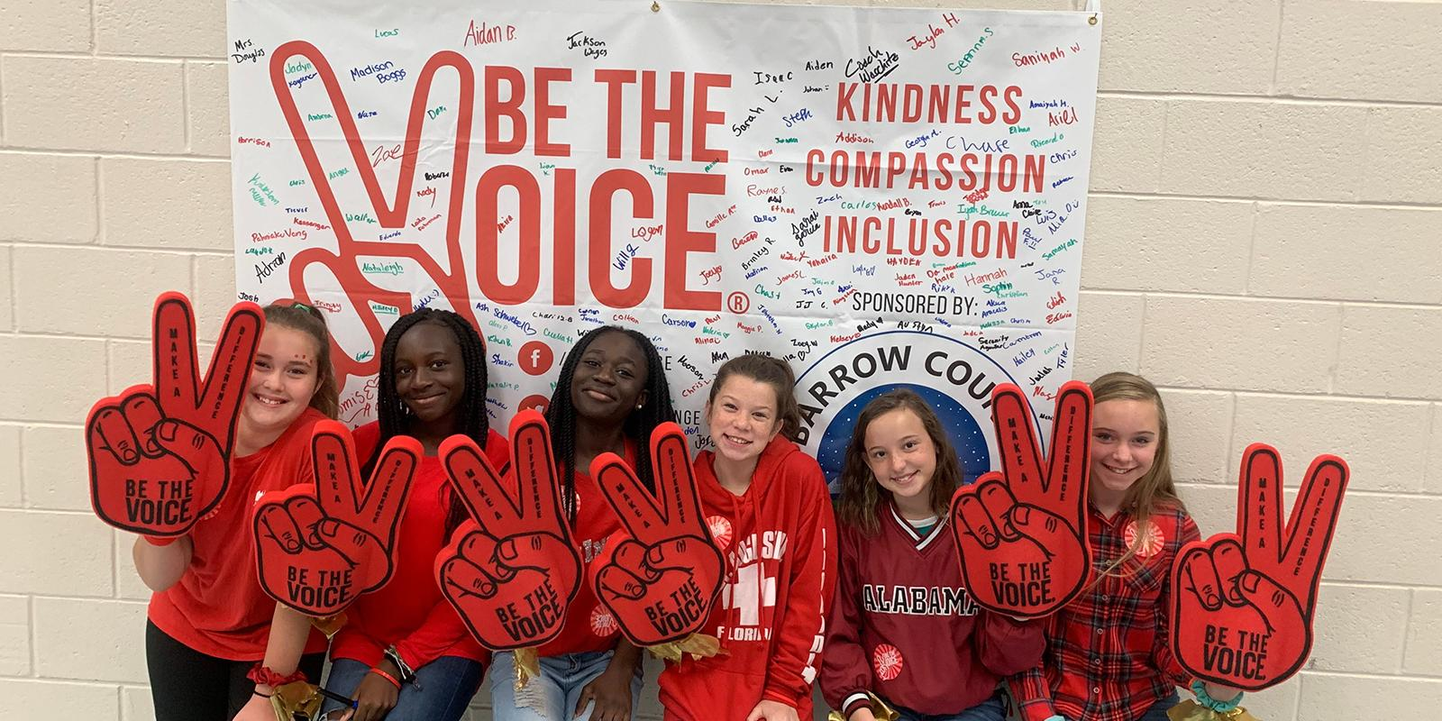Students promoting the Be the Voice Campaign