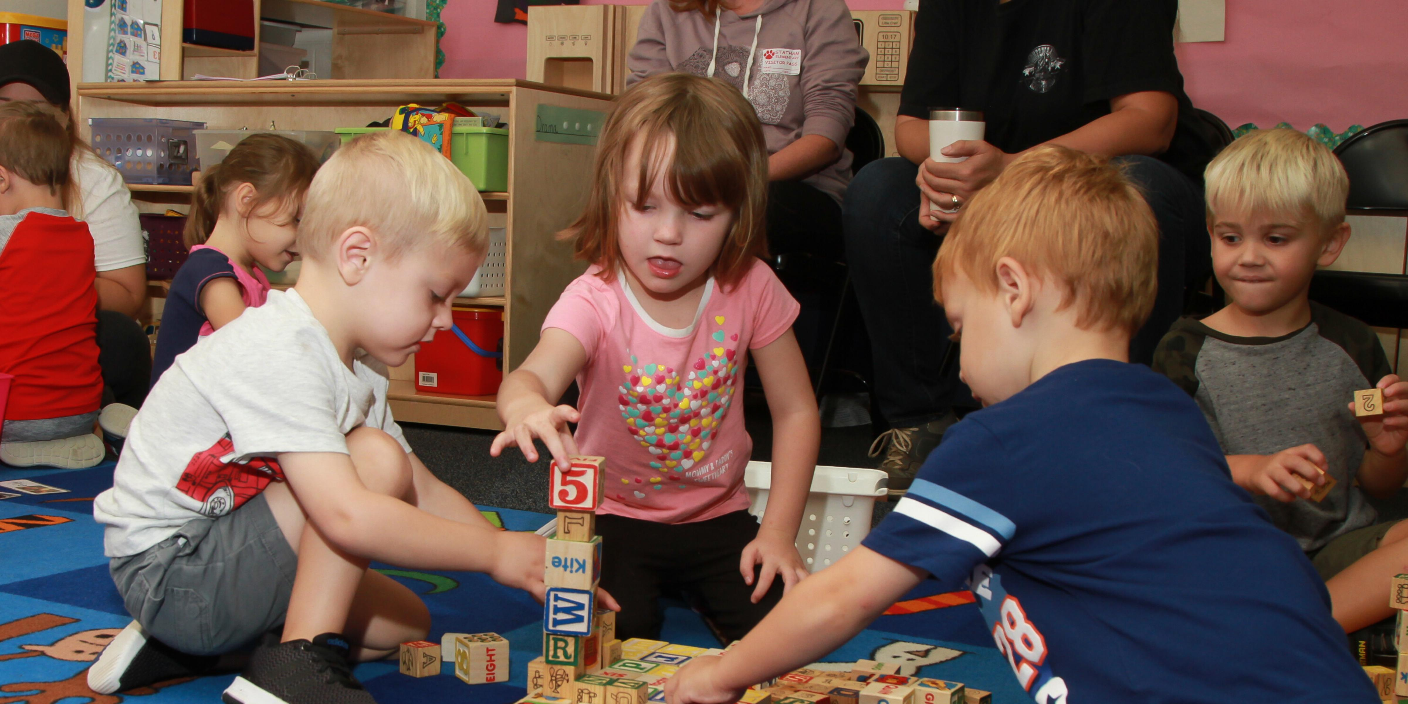 Students playing blocks in a classroom