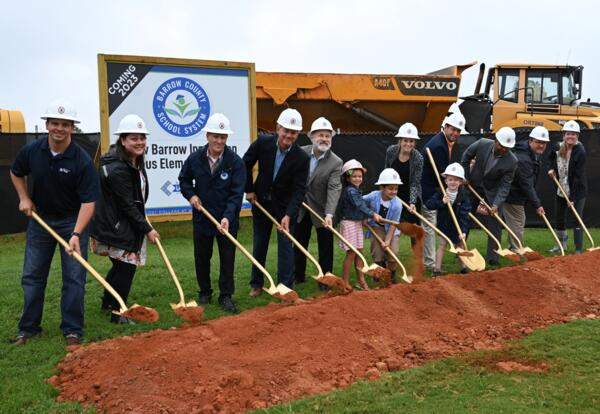 Superintendent, School Board Members and Students tossing dirt for groundbreaking