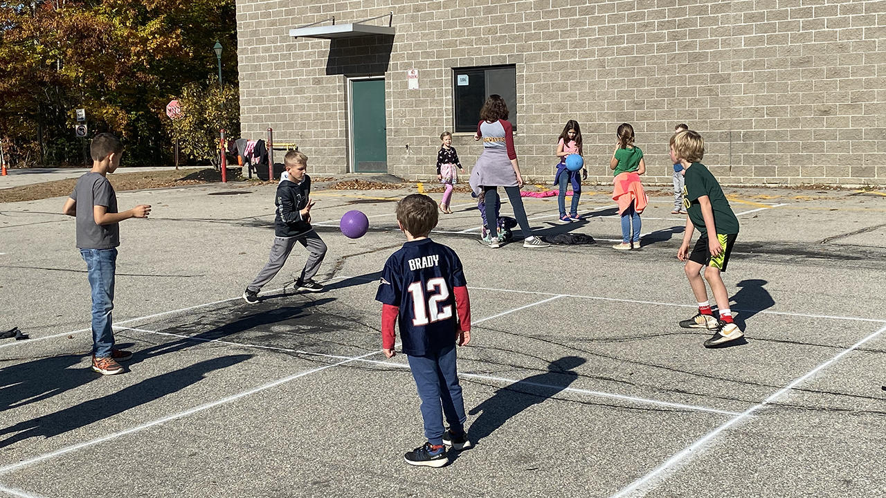 students playing four-square