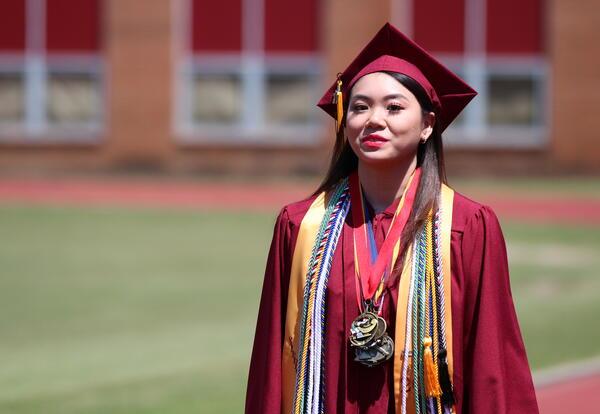 Valedictorian Kimberlynn Mai in cap and gown