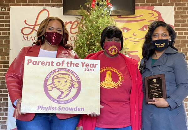 Superintendent Dr. Watts, Parent of the Year Phyliss Snowden and Principal Dr. Pendleton holding awards