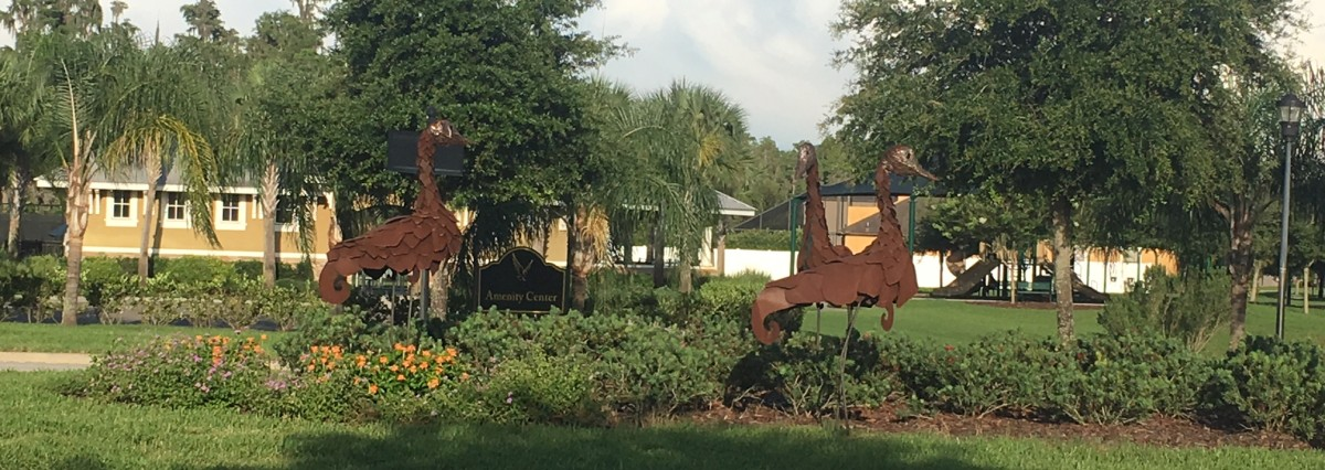 Sculptures in front of Amenity Center Sign