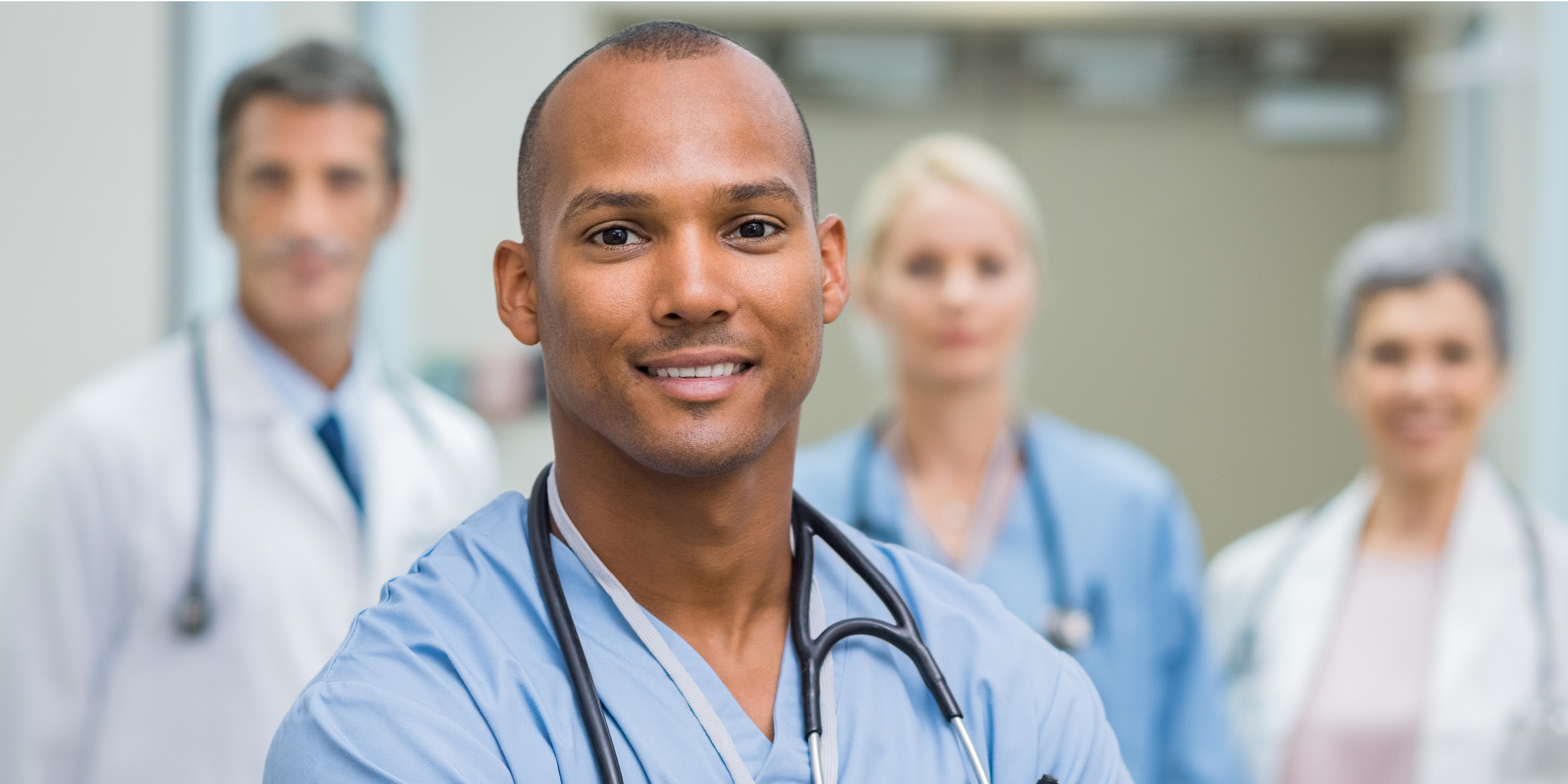Male Nursing Student with peers in background