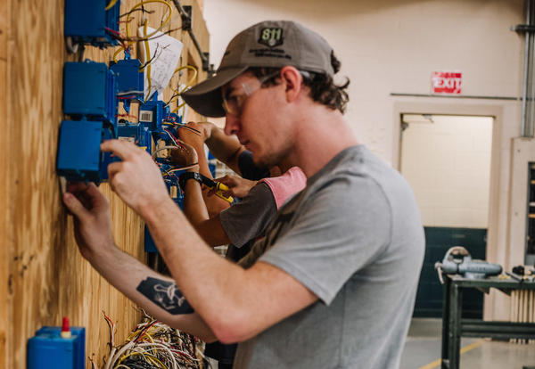 Student doing electrical work