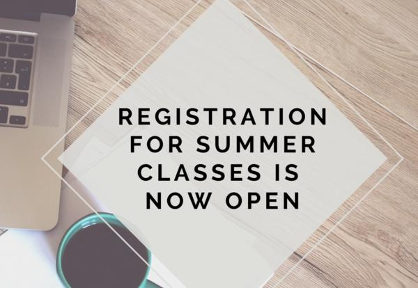Computer with a sign that says registration now open for summer session