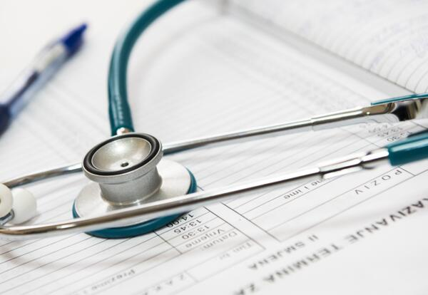 stethoscope and medical paperwork