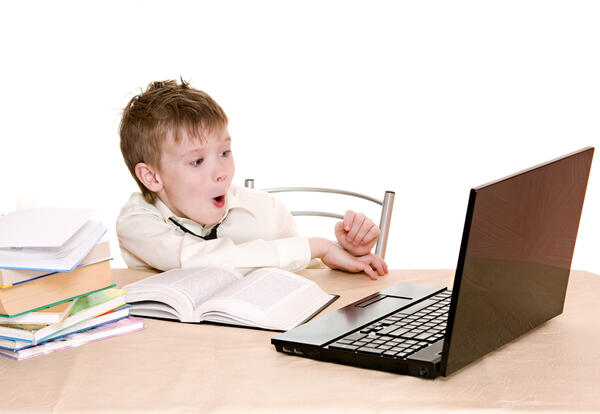 Young student excited about online learning.