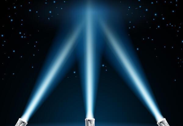 3 spotlights shining into the night sky