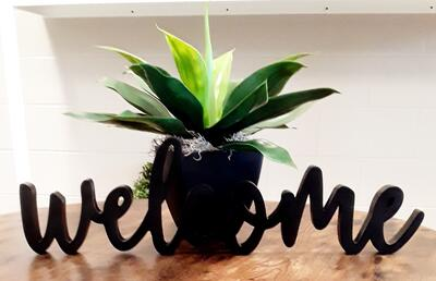 Welcome image with a flower in a flower pot