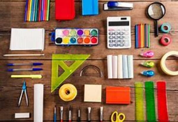 photo of miscellaneous school supplies laid out on a desk or table