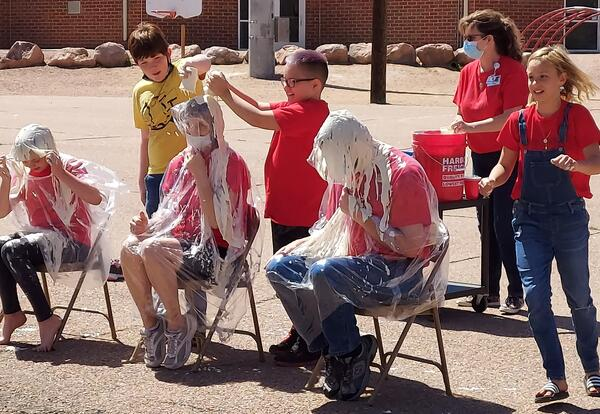 Students who raised $75 or more got to throw slimy stuff at Mr. Morton (our principal), Mrs. Freehling (our PE teacher), and Kylie (top fundraising student).