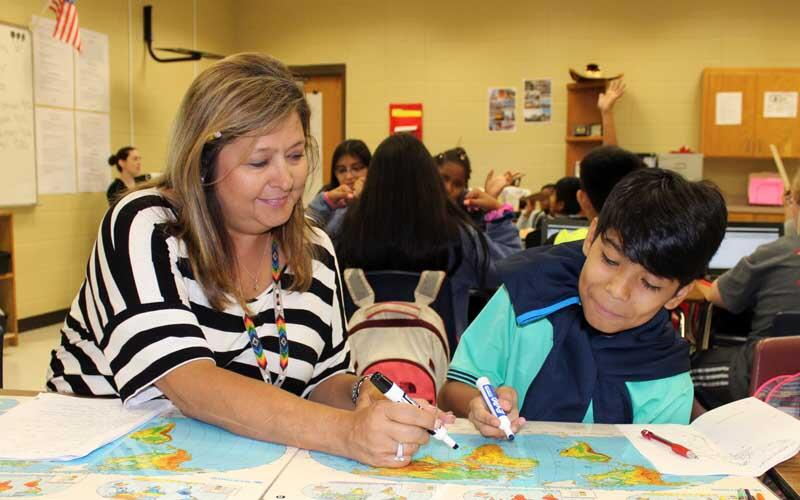 Photo of teacher working with student