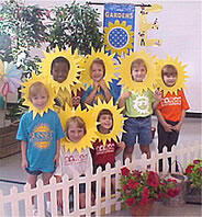 Young students wearing sunflower masks around their faces