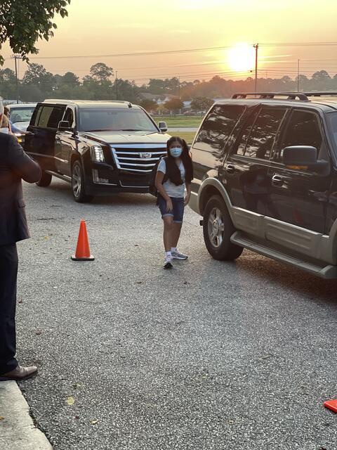 Candid photo: Student at car drop off.