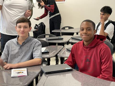 Candid Photo:  Two  high school boys in a classroom.