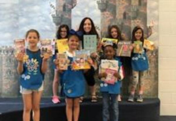 Indian Trail and Kingsley Daisy scouts donate books to school libraries