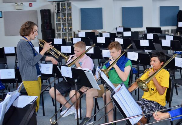 students performing instrumental music