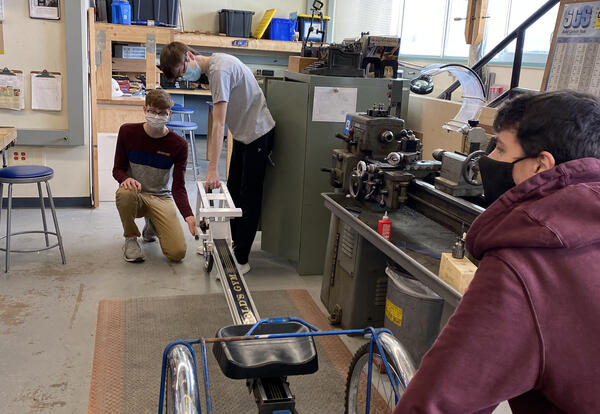 LHS students working on rowing tricycle prototype.