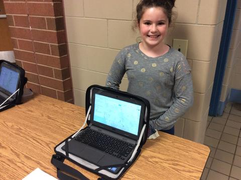 Student shows Chromebook project