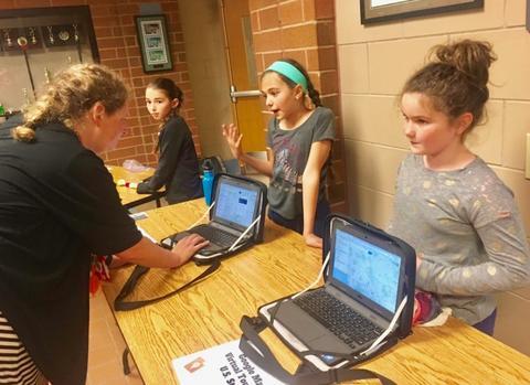 Student explains project to ITC Kara Pottinger
