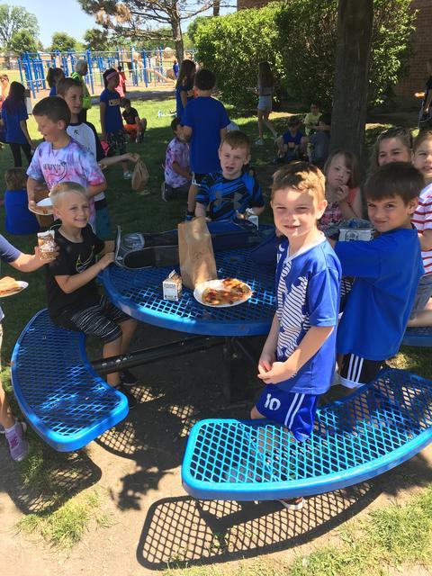 Students eating at picnic table