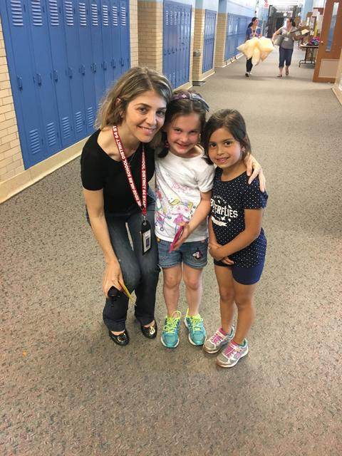 Two students pose with Assistant Principal