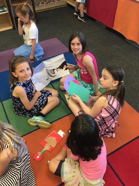 Students reading on color block rug