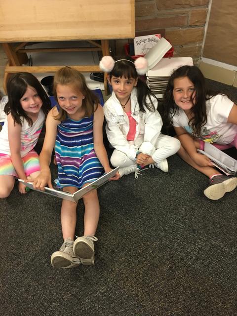 Girls sharing a book
