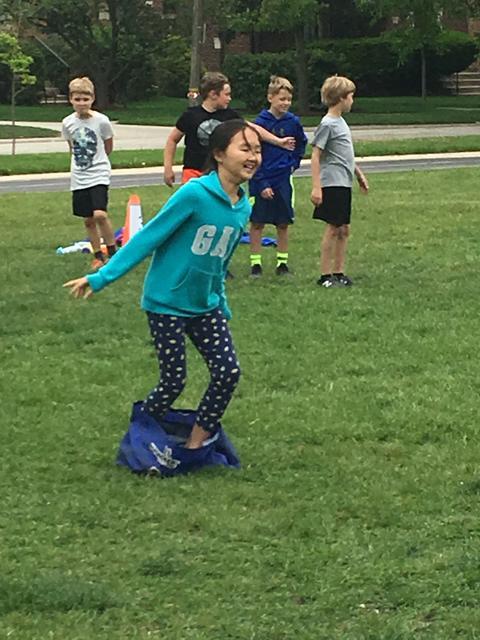 Girl running sack race