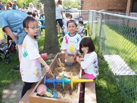 Students playing in sandbox